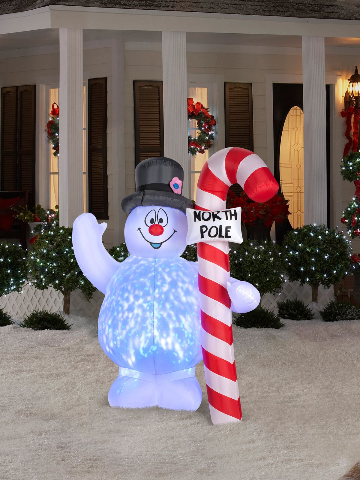 frosty hugging north pole sign projection light airblown lawn decor - North Pole Christmas Decorations